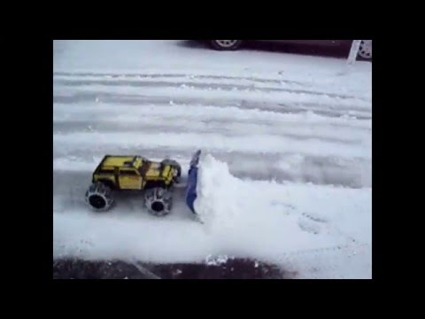 Traxxas Summit with homemade snow plow  !!