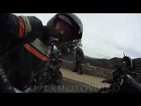 DRZ 400 SUPERMOTO CHASING A SUPER FAST R1 ON THE SNAKE.mp4