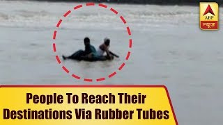 Madhya Pradesh: People use rubber tubes to cross Parwati river - ABPNEWSTV
