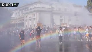 Water cannons, rocks & rainbows: Climate change protest turns violent in Chile - RUSSIATODAY