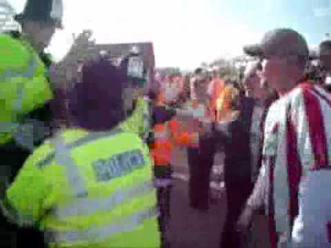 Saints fan punched by police officers
