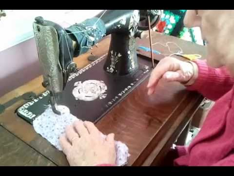 Norma using her 100 year old Singer Treadle Sewing machine.