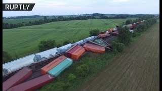 Drone footage: Train derails in Canada, 2 carriages with propane fall into river - RUSSIATODAY