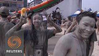 Revellers party in South Korea's capital of mud - REUTERSVIDEO