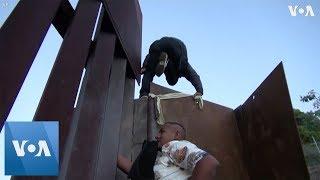 Migrants Continue to Breach US Border Wall - VOAVIDEO