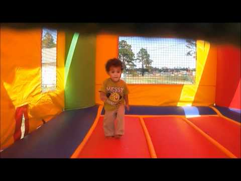 18 month old baby in action bounce house