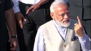 Ahmedabad: PM Modi casts his vote in Ranip, arrives in open jeep - ZEENEWS
