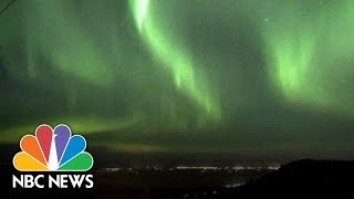 Watch The Green Glow Of The Northern Lights Across The Alaskan Sky | NBC News - NBCNEWS