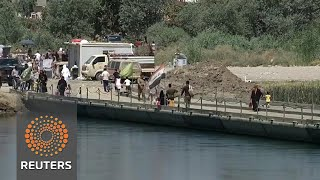 One pontoon bridge connects Mosul's shattered halves - REUTERSVIDEO