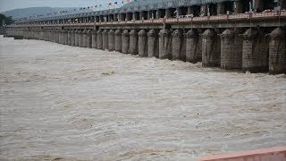 Watch: Prakasam Barrage opens all 70 gates after heavy inflow from catchment areas - TIMESOFINDIACHANNEL