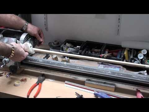 Cleaning a pool cue using a cue lathe