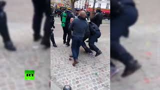 Macron aide beats up student protester during May Day rally - RUSSIATODAY