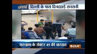 Guard shoots judge's son, wife at a market in Gurugram - INDIATV