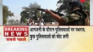 Madhya Pradesh: Police use tear gas shells on devotees - ZEENEWS