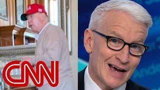 Anderson Cooper reacts to Trump's golf trip after declaring emergency - CNN