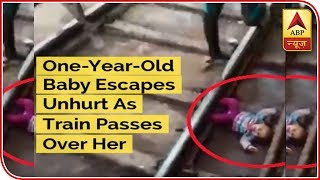 One-Year-Old Baby Escapes Unhurt As Train Passes Over Her - ABPNEWSTV