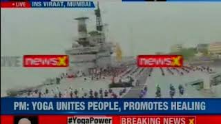 Maharashtra: Navy personnel perform Yoga on board INS Virat, which is stationed in Mumbai - NEWSXLIVE