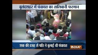 Uttar Pradesh: Husband beats woman in public on Panchayat's order in Bulandshahr - INDIATV