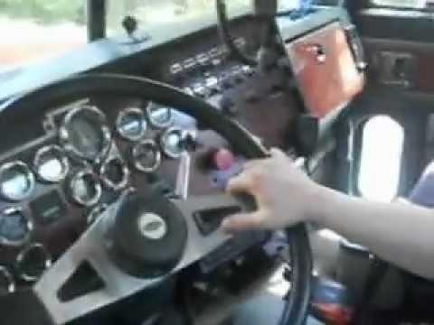 Loud Jake brake and down shifting cat engine Peterbilt logging truck.
