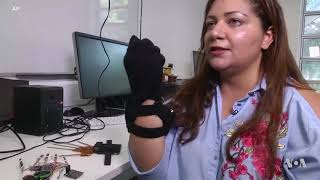 Talking Gloves and Tactile Windows Provide Help for the Disabled - VOAVIDEO