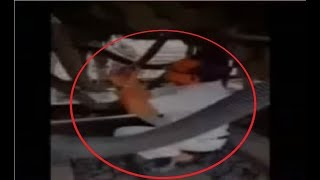 Visuals caught on camera of Train Guard of Howrah Digha Super fast express hanging under the train - NEWSXLIVE