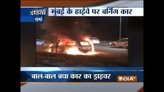 Moving car catches fire on Eastern Express highway in Mumbai - INDIATV