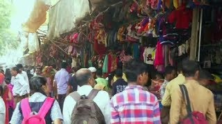 Heavy rush of shoppers throng Tibetan woollen market ahead of winters in Surat - TIMESOFINDIACHANNEL