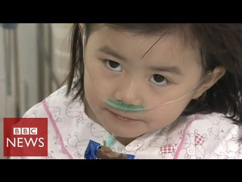 Video shows 6 year-old rescued from sinking ferry in South Korea - BBC News