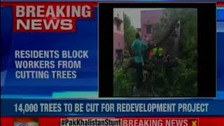 Delhi Chipko: After staging candle light march protest, citizens try to stop tree chopping - NEWSXLIVE