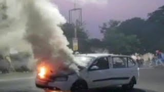 Moving car catches fire in Gujarat's Kheda - TIMESOFINDIACHANNEL