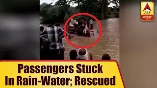 Madhya Pradesh: Bus with 50 passengers stuck in rain-water; rescued - ABPNEWSTV