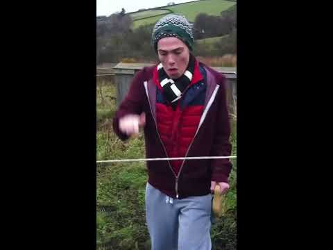 Incredibly camp man shocks himself on electric fence...