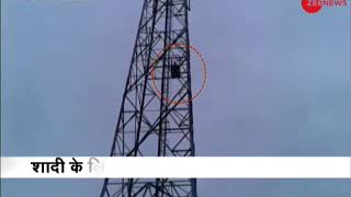 Telangana women climbs a cell phone tower - ZEENEWS