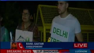 South Delhi residents protest against tree falling; 14,000 trees to be cut for redevelopment project - NEWSXLIVE
