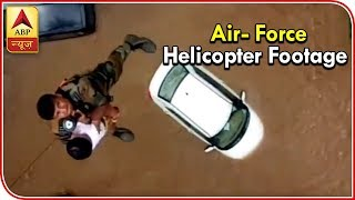 Kerala: Watch how a woman and her son were rescued by air-force helicopter - ABPNEWSTV
