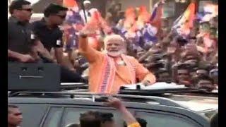 Modi in Varanasi: PM Begins Roadshow Amid Sea of Saffron - ZEENEWS