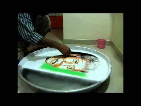 RANGOLI ON WATER NELSON MANDELA BY RAVINDRA MORE