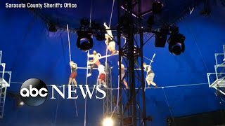 New video shows collapse of 8-person pyramid balancing on wire 25 feet above ground - ABCNEWS