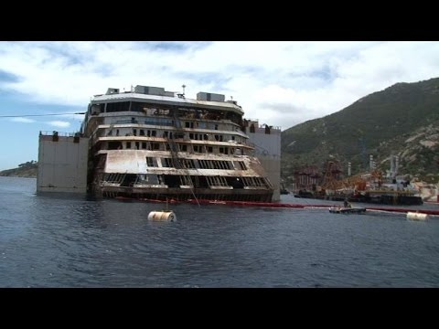 Costa Concordia survivors view shipwreck as it is lifted