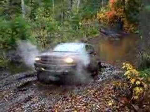 "(getting a mud bath) That's a 2001 Durango SLT, running 32s with 2"" t/s lift"