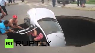 Giant sinkhole swallows car with family still inside in Peru - RUSSIATODAY