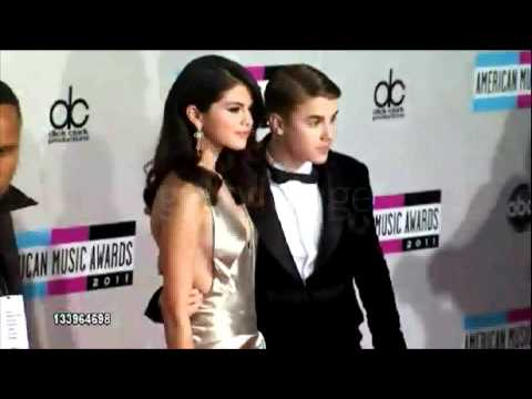 Selena Gomez &amp; Justin Bieber walking the Red Carpet at American Music Awards 2011