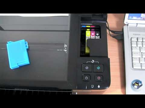 How to Change Ink Cartridges with a Epson Stylus SX125