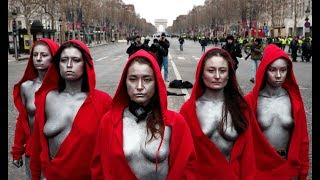 Topless 'Mariannes' confront police during 'Yellow Vest' protest - RUSSIATODAY