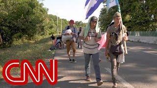 Migrants continue north, reject Trump's tweets - CNN