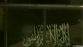 فيديو: علم الإسلام فوق رهائن استراليا