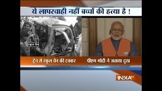 Extremely saddened on hearing about the death of school kids in a van-train collision: Modi - INDIATV