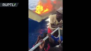 RAW: Migrant boat set on fire by Libyan coastguard in Mediterranean - RUSSIATODAY
