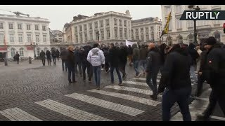 Protesters rally in Brussels against UN migration pact adoption - RUSSIATODAY