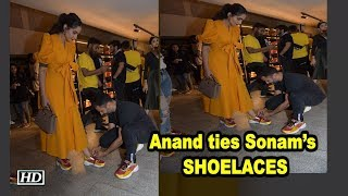 Anand ties Sonam's SHOELACES, Giving husband goals - IANSLIVE